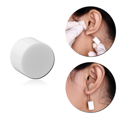POLYMER STOPPER FOR PIERCING NEEDLE